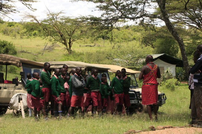 The school pupils learn from Silver Guide Jackson   Liaram about managing a safari camp