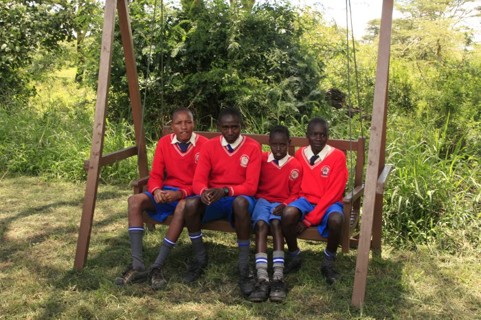School children try out a swing chair at Porini Mara Camp
