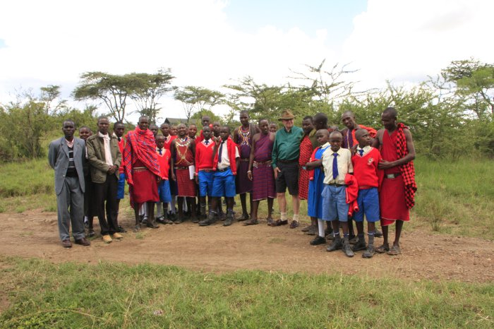 Teachers and pupils from Ol Kinyei Primary School with   Porini Mara Camp staff and Managing Director, Jake   Grieves-Cook