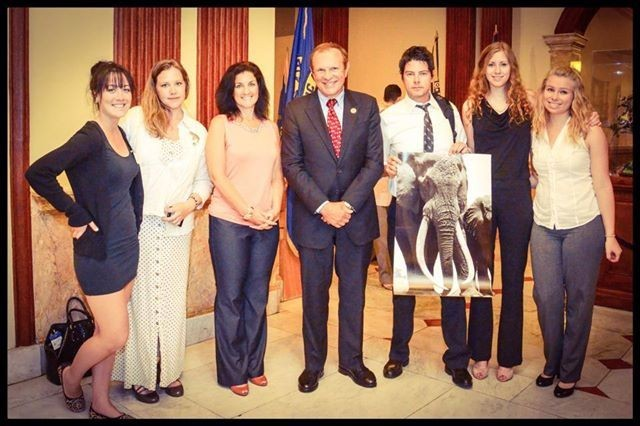 Senator Raymond J. Lesniak stands with advocates from Elephants DC and the Humane Society after the historic passage of New Jersey's ivory and rhino horn sales ban. The elephant pictured is Satao, the largest tusker in Kenya recently slaughtered by poachers. © Rebecca Nowalski.
