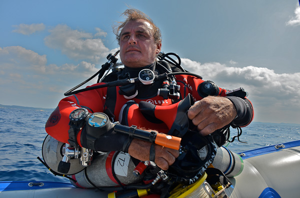 Peter Timm, with Trimix diving gear, getting ready to dive down to more than 100 metres