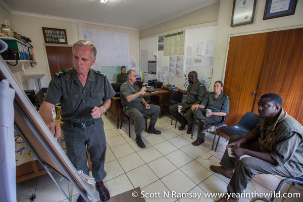 General Jooste (left) briefs some of Kruger's section rangers, who are at the frontlines of the war against poachers.