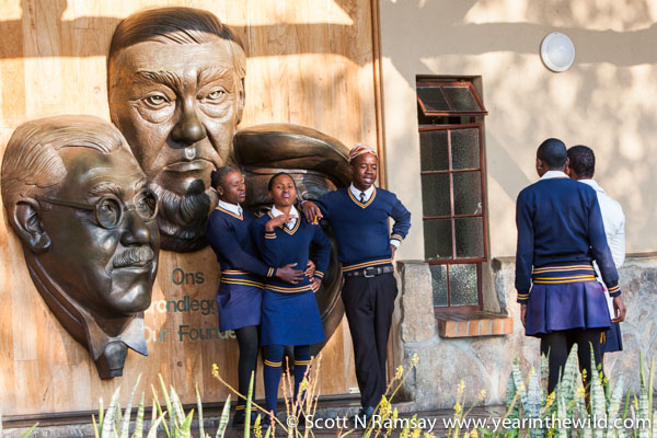 The old and the new - I spotted these school kids posing for photos in front of the memorial to the founders of Kruger