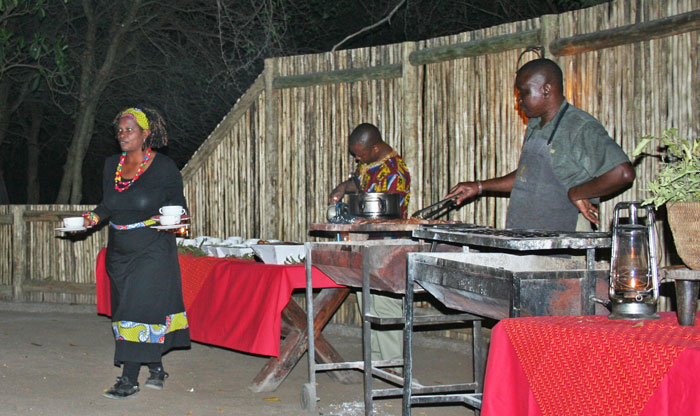 At Tanda Tula, enjoying a hearty meal cooked on the fire at the end of a long day.