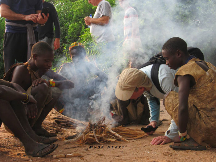 Hadzabe-try-getting-fire-going-with-tourists-