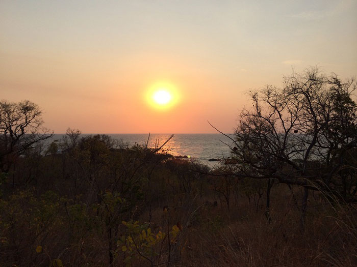The sun starting to set on the walk through the wilderness to Nkwichi © Robyn Frick