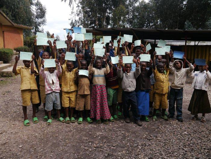 Sabyinyo-Silverback-Lodge-signs-school-children