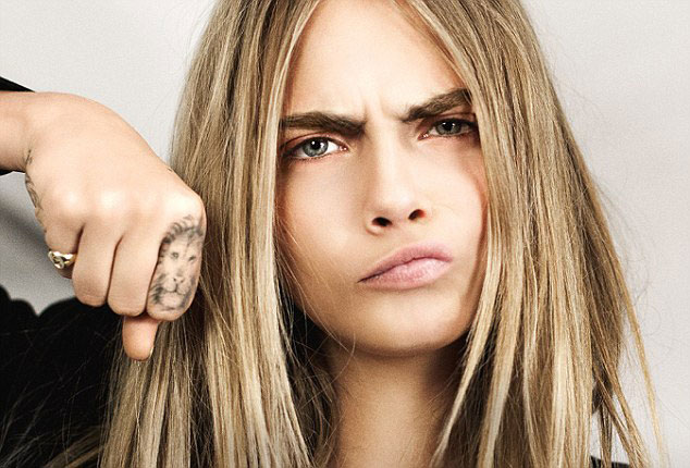 cara-delevingne-lion-tattoo