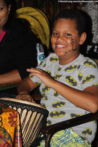 A young boy enjoying drumming