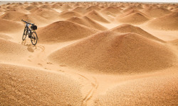 Cycling through sand dunes in Sudan