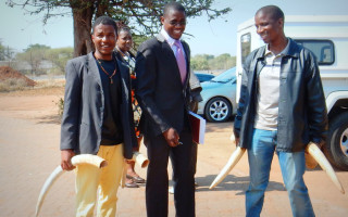 Outside the court after the first trial: investigating police officer, Detective Constable Kagiso M (middle), and two colleagues with the four ivory tusks as evidence.