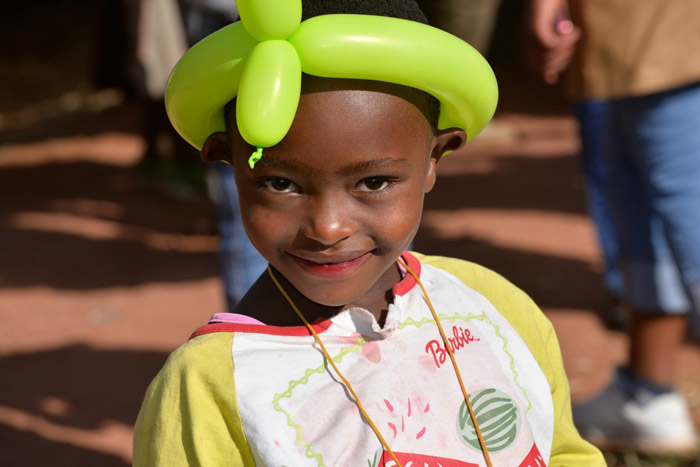 Child with balloon hat