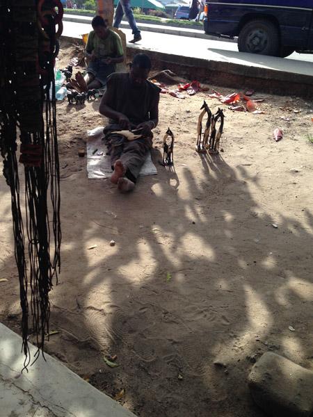 Carving wood outside Mwenge Craft Market