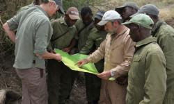 De Toit discusses anti-poaching tactics with his team in Zimbabwe. ©  Goldman Environmental Prize