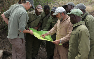 De Toit discusses anti-poaching tactics with his team in Zimbabwe. ©  Goldman Environmental Prize
