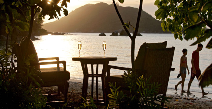 Champagne at sunset on the resort's north beach © Constance Hotels & Resorts