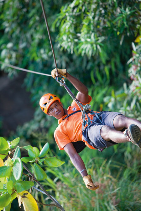 Ziplining through the forest © Constance Hotels & Resorts