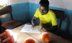 Working by the light of solar lamps at St Martin's school in Nambuma, Malawi. © John Vidal for the Guardian