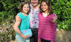 The author, Judy Maré with Grace and Kiara who raised money for the campaign at their school.