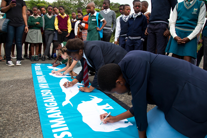 Children signing banners