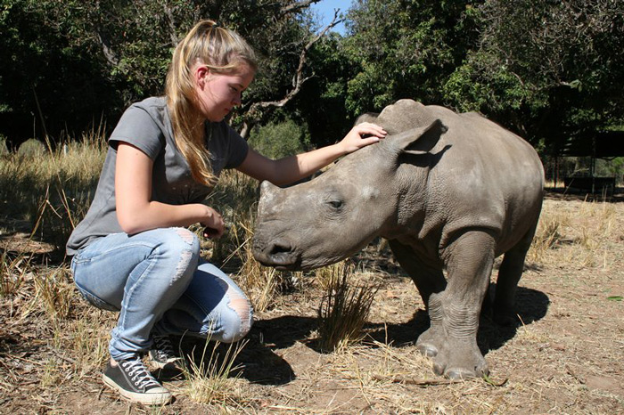 Laura Bolton at Care for Wild Africa with a rhino orphan