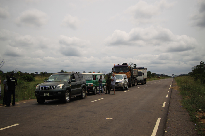 2. Vehicles line up at Yengo-Mambili check point. A team of eco-guards from Odzala-Koukoua National Park permanently mans Yengo-Mambili control post. The boom gate is the only permanent wildlife product focused control post on the main road from northern Congo to the urban areas in the south.