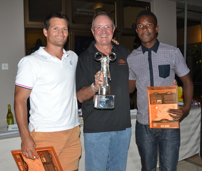 Winners Blair Taberer (left) and Munya Mudyanadzo (right) being presented with their trophy by AAT group chairman Dave Glynn