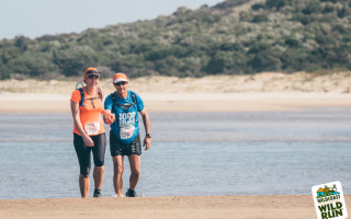 Janine Mazery and her father Larry Claassen cross the Mbhashe River on day 2 of the Wildcoast Wildrun®