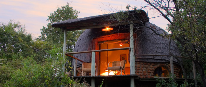 Sleep in a traditional 'rondavel' in a game reserve at Isibindi Zulu Lodge © Guy Upfold