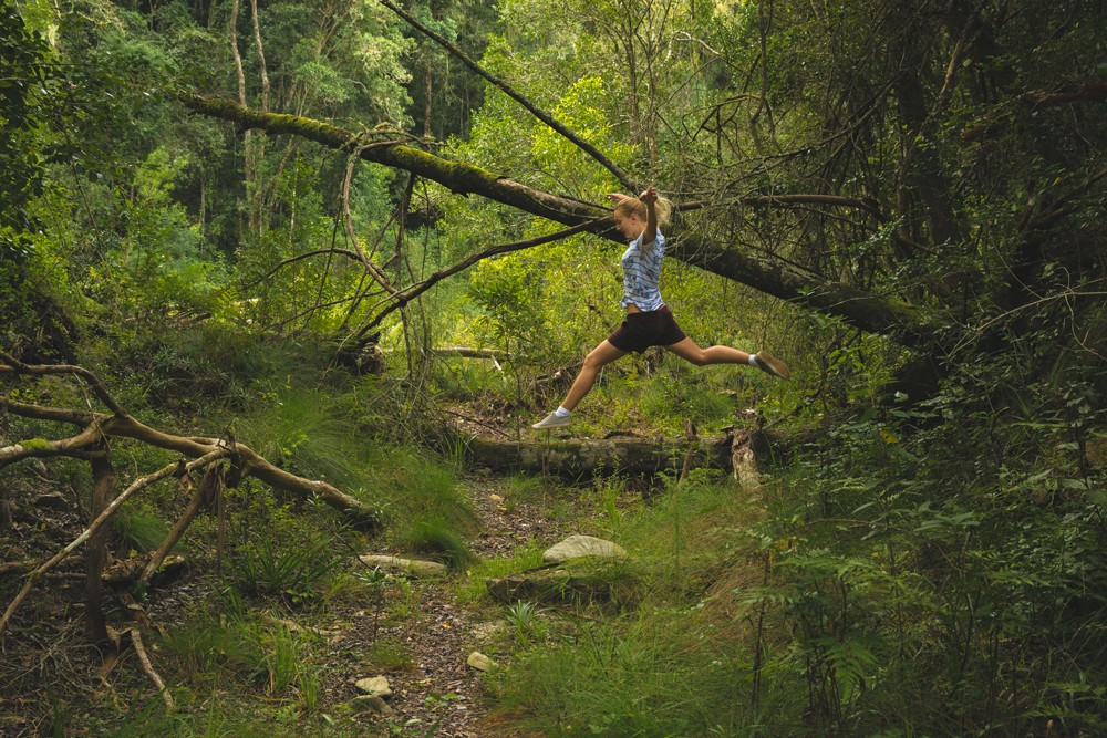 jumping-in-forest-teniqua-treetops
