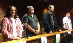 Arno Smit (third from left) alongside fellow accused rhino poachers ©OSCAP