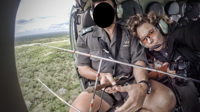 Susan Scott films from a helicopter with SANParks rangers
