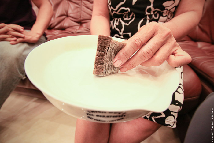 A cancer patient using rhino horn in a traditional grinding bowl in Vietnam. © Susan Scott for STROOP