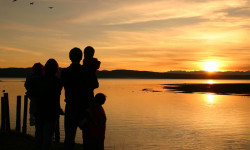 family-overlooking-sunset-safari