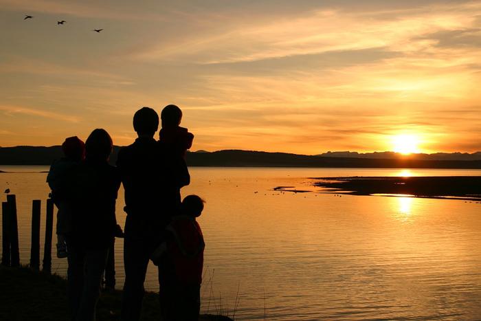 family-overlooking-sunset-safari