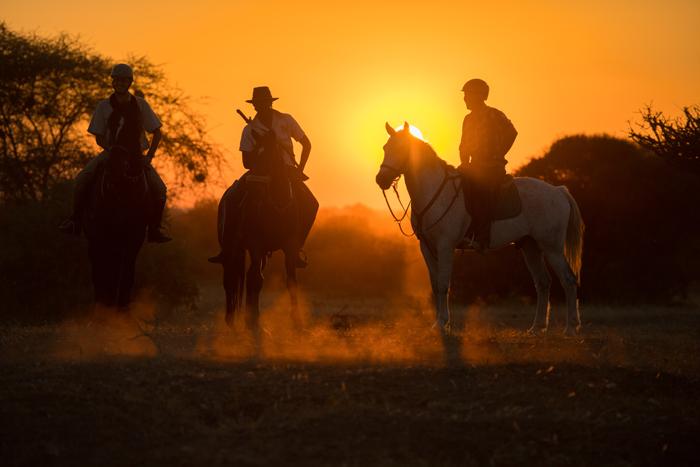 horseback-safari-sunset
