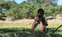 boy-practising-photography-on-safari