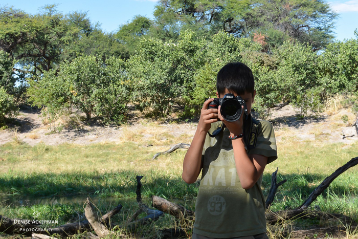 boy-practising-photography-on-safari