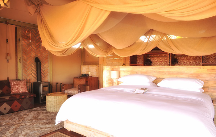 Find comfort in a deluxe bedroom at Somalisa Acacia Camp in Zimbabwe