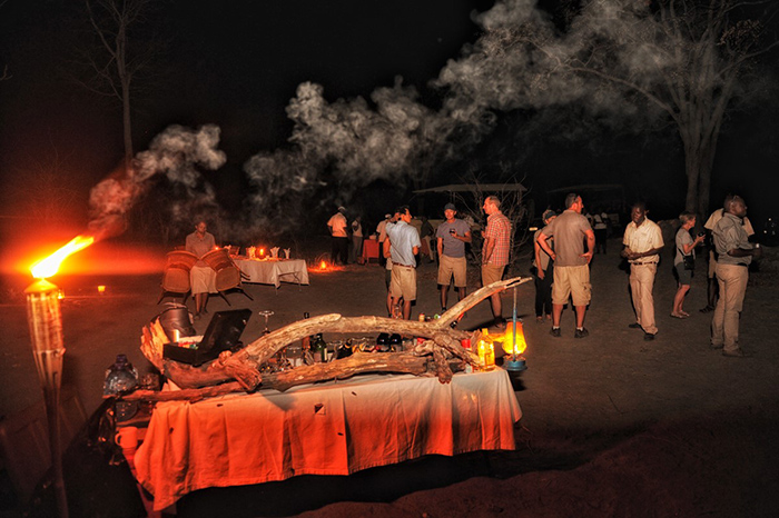 Guests feel the warmth of fire, refreshments and friends