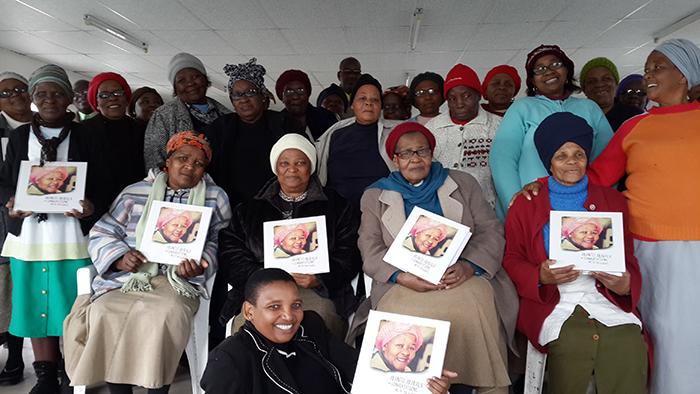 Seniors receiving copies of Abantu Abadala book