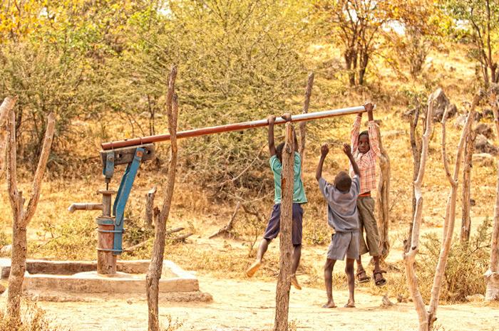 children-pumping-water