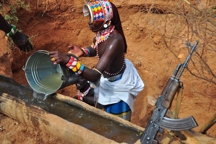 at-the-singing-wells-the-samburu-morane-retreives-water-chanting-as-they-work-sometimes-the-wells-are-up-to-7-men-deep