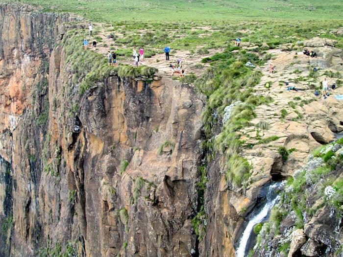 hikers cliff top Tugela Falls, Amphitheater, Drakensberg, South
