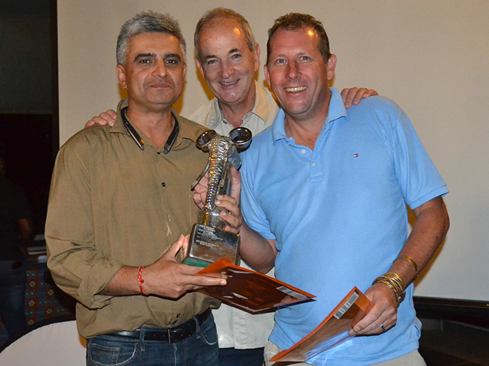 winners-sanjay-babbar-left-and-tom-austin-right-receive-their-trophy-and-prizes-from-aat-chief-executive-ross-kennedy