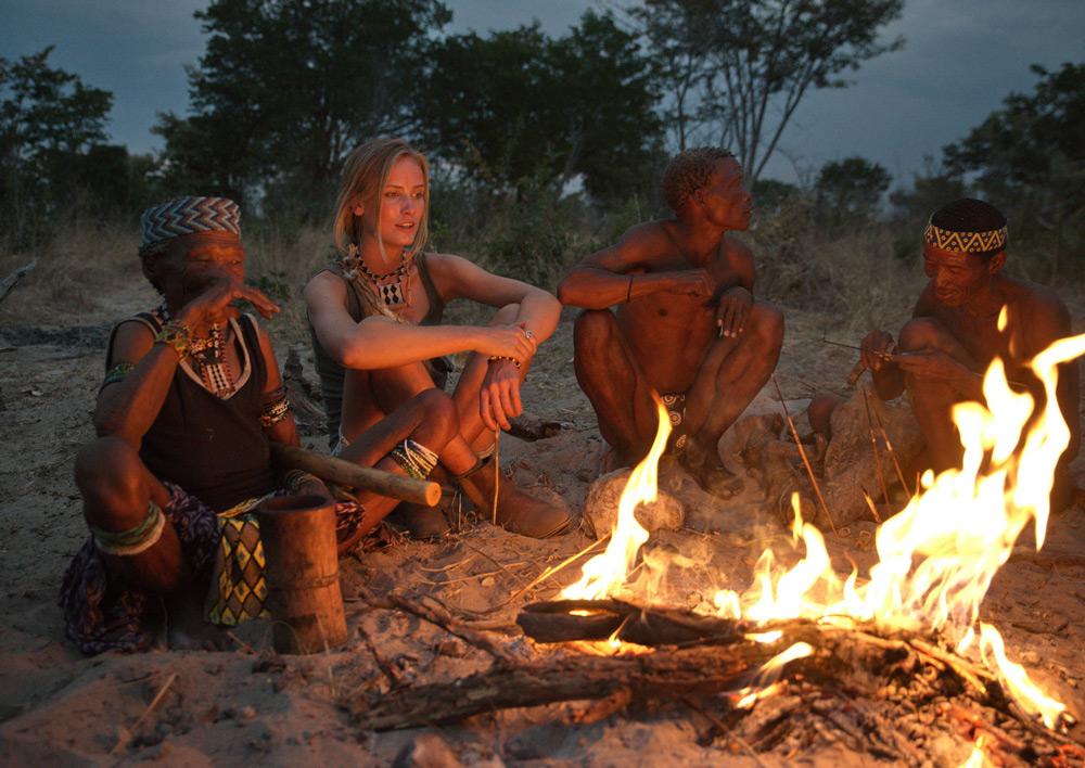 san-bushmen-and-model-around-fire