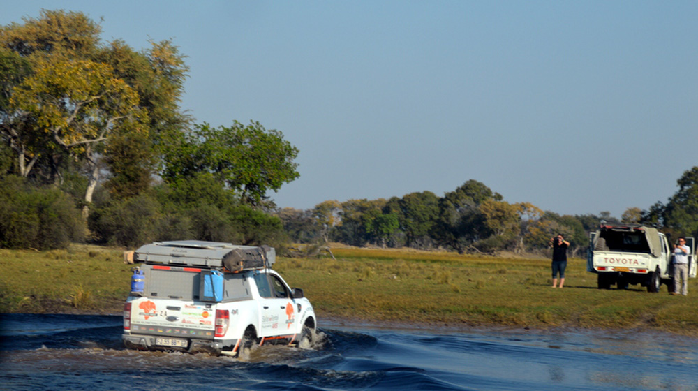 Vehicles crossing the river in the eastern panhandle of the Okakango Delta