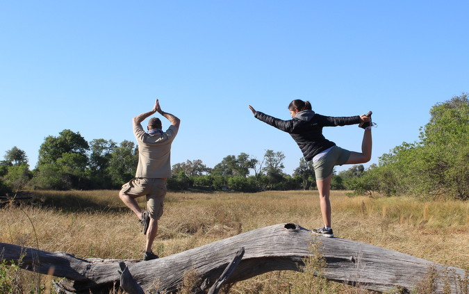 people doing yoga in the African bush