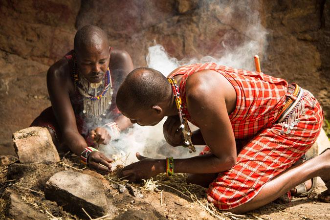 Kakiya cave, building a fire, Masai Mara, Kenya