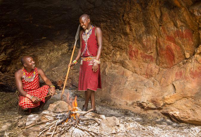 Kakiya cave, rock paintings and fire, Masai Mara, Kenya